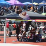 Keshoun clearing the high jump bar at the regional championship