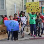 Ile Omode students promoting safe and healthy neighborhoods